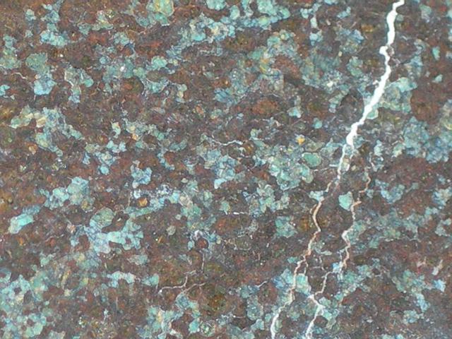 NWA 1464 - urelit. Urelity są meteorytami bogatymi w oliwin i pigeonit. Zwykle mają dość dużą zawartość węgla (~3%). Znane są przede wszystkim z występowania w nich nanodiamentów.  Źródło zdjęcia:   http://www.pallasite.ca/